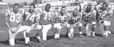 Original Chargers Dave Kocourek, Ron Mix, Ernie Wright, Don Norton, Dick Harris, Paul Lowe and Don Rogers at Escondido training camp in 1964, shortly before moving to Sunset Park for regular season practices.